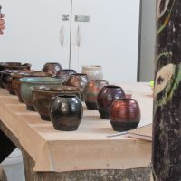Raku pot glazing and firing